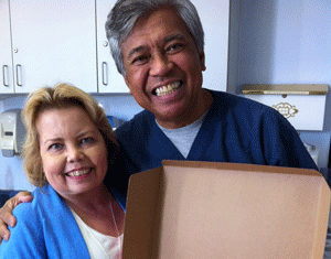 Lori Hartwell and dialysis nurse Marc Manolo, RN